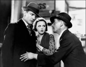 Tracy (Donald Calthrop) attempts to blackmail Alice and her policeman boyfriend Frank (John Longden) in Alfred Hitchcock's Blackmail (1929)
