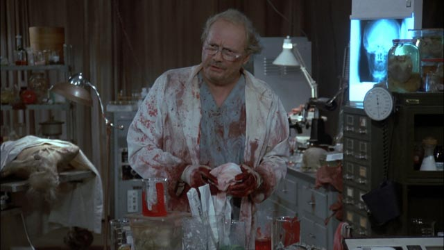 The mad scientist Logan (Richard Liberty) seeks the human in the zombie in George A. Romero's Day of the Dead (1985)