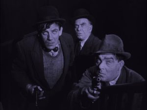 The party come for Gypo (Lars Hanson), who is finally ready for his fate in Arthur Robison's The Informer (1929)