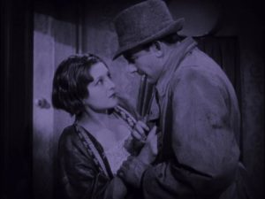 Party boss Gallagher (Warwick Ward) demands that Katie (Lys De Putti) give up Gypo's whereabouts in Arthur Robison's The Informer (1929)