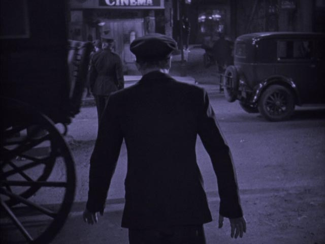 Gypo (Lars Hanson) walks to the police station as if in a trance in Arthur Robison's The Informer (1929)