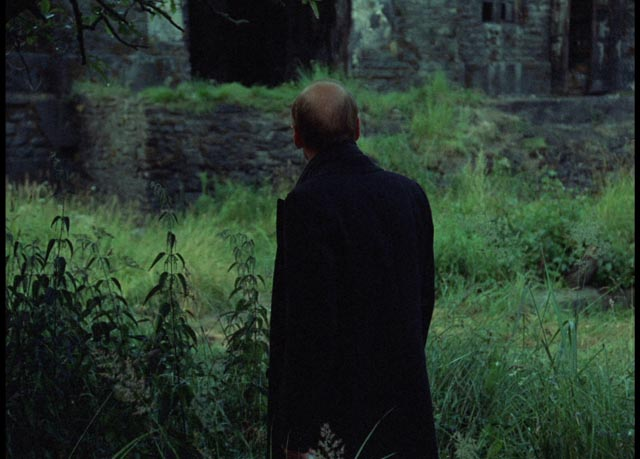 The Writer is stopped before he reaches the building which houses the Room in Andrei Tarkovsky's Stalker (1979)