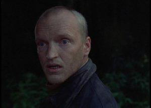 Alexander Kaindanovsky as the Stalker, a holy fool striving to enlighten his cynical companions in Andrei Tarkovsky's Stalker (1979)