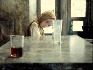 The Stalker's crippled daughter Monkey (Natasha Abramova) moves a glass across the table with her mind in Andrei Tarkovsky's Stalker (1979)