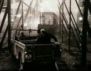 Breaking through the barrier which bars entry to the Zone in Andrei Tarkovsky's Stalker (1979)