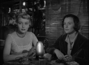 Femme fatale Leona (Patricia Neal) meets wife Lucy (Phyllis Thaxter) in Michael Curtiz's The Breaking Point (1950)