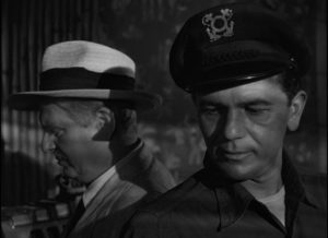 Harry reluctantly listens to a proposal from sleazy lawyer Duncan (Wallace Ford) in Michael Curtiz's The Breaking Point (1950)