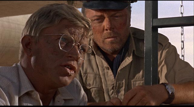 Hardy Kruger as engineer Dorfmann and Richard Attenborough as co-pilot Lew Moran in Robert Aldrich's The Flight of the Phoenix (1965)