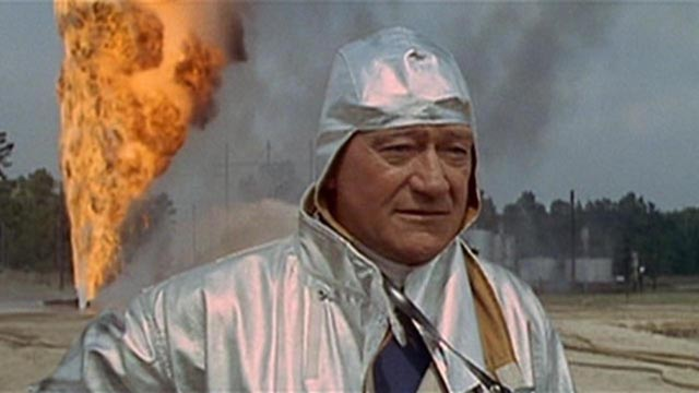 John Wayne prepares to douse an oil well fire in Andrew V. Mclaglen's Hellfighters (1968)