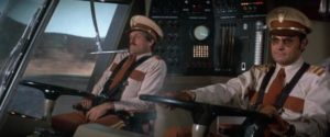 Joseph Bologna (r) as Captain of The Big Bus, with co-pilot John Beck