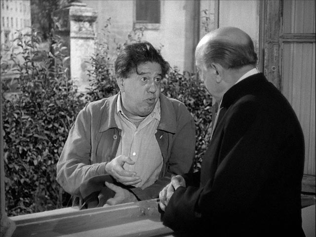 Braconnier complains about his marriage to the village priest (Jean Duvaleix) in Sacha Guitry's La poison (1951)