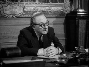 Advocate Aubanel (Jean Debucourt) inadvertently provides Braconnier (Michel Simon) with a plan for murder in Sacha Guitry's La poison (1951)
