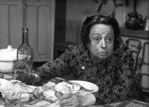 Mme. Braconnier (Germaine Reuver) has equal contempt for her husband in Sacha Guitry's La poison (1951)