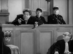 Braconnier (Michel Simon) argues that the law supports his act of murder in Sacha Guitry's La poison (1951)