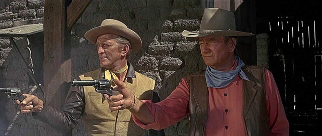 John Wayne and Kirk Douglas as friendly rivals in Burt Kennedy's The War Wagon (1967)