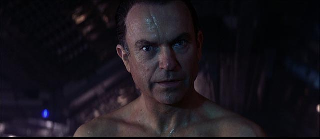 Scientist William Weir (Sam Neill) is seduced by evil in Paul W.S. Anderson's Event Horizon (1997)