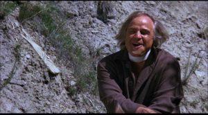 Marlon Brando as Lee Clayton, a killer who really enjoys his work in Arthur Penn's The Missouri Breaks (1976)