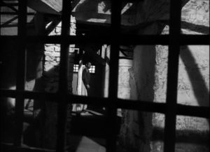 Othello is increasingly contained within a prison conjured by his own emotions in Orson Welles' Othello (1952/55)