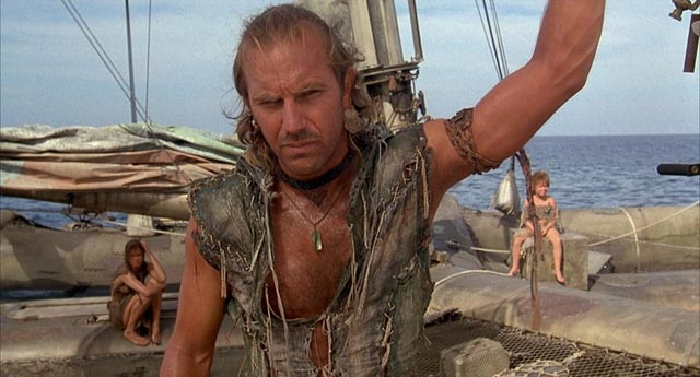 The Mariner (Kevin Costner) reluctantly takes on passengers Helen (Jeanne Tripplehorn) and Enola (Tina Majorino) in Kevin Reynolds' Waterworld (1995)