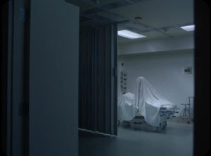 The spirit of C reawakens in the morgue in David Lowery's A Ghost Story (2017)