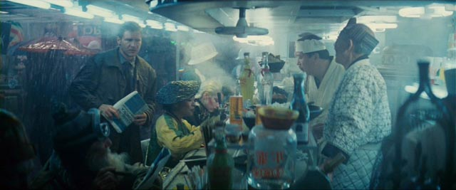 Deckard (Harrison Ford) orders noodles in a crowded street in Ridley Scott's Blade Runner (1982) ...