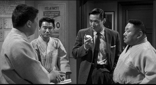 Detective Joe Kojaku (James Shigeta) seeks information Los Angeles' Japanese community in Samual Fuller's The Crimson Kimono (1959)