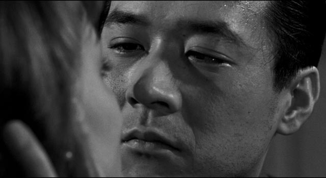Joe is conflicted by his attraction to Christine (Victoria Shaw) in Samuel Fuller's The Crimson Kimono (1959)