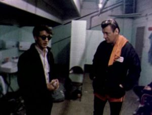 Mike Snell seeks advice from Charley O'Connell about how to get into roller derby in Robert Kaylor's Derby (1971)