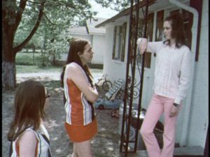 Christina confronts a woman she suspects of having an affair with Mike in Robert Kaylor's Derby (1971)