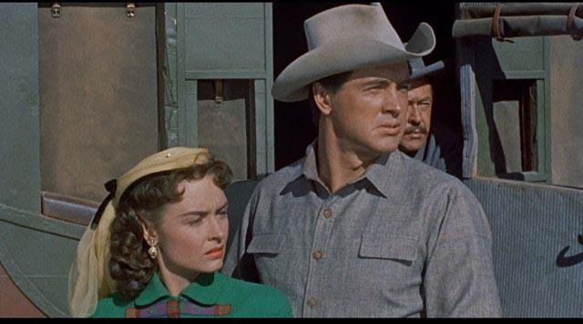 The westward journey of Ben Warren (Rock Hudson) and Jennifer Ballard (Donna Reed) is interrupted in Raoul Walsh's Gun Fury (1953)