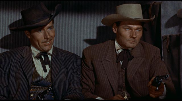 Southern gentlemen Philip Carey and Leo Gordon reveal their hidden motives in Raoul Walsh's Gun Fury (1953)