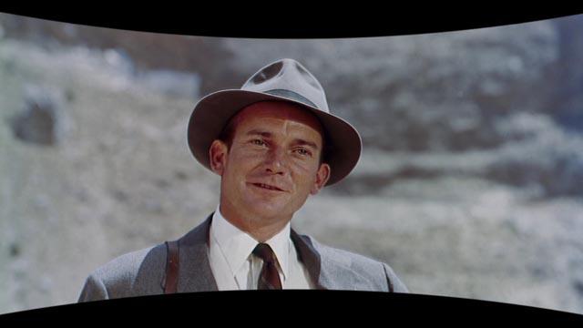 Denholm Elliott as dim-bulb writer Oliver Larker in Jack Cardiff's Holiday in Spain (1960)