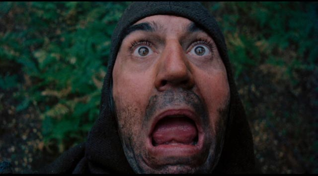 A poacher (Terry Jones) is surprised by the beast in Terry Gilliam's Jabberwocky (1977) ...