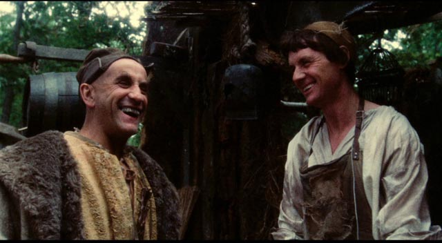 Dennis (Michael Palin) tries to bargain with a customer (Warren Mitchell) in Terry Gilliam's Jabberwocky (1977)