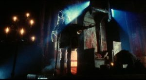 The herald (John Bird) announces the approach of the king in the throne room in Terry Gilliam's Jabberwocky (1977)