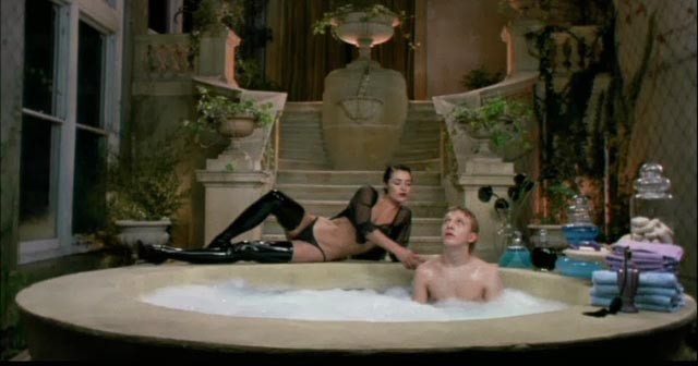 Lady Sylvia washes her food before eating in Ken Russell's Lair of the White Worm (1988)