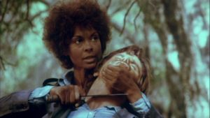 Carmen (Ena Hartman) has no intention of submitting to the men on Stephanie Rothman's Terminal Island (1973)