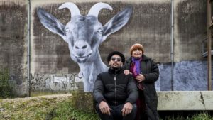 JR and Agnes Varda with a goat being defiantly itself in Agnes Varda's Visages Villages (2017)