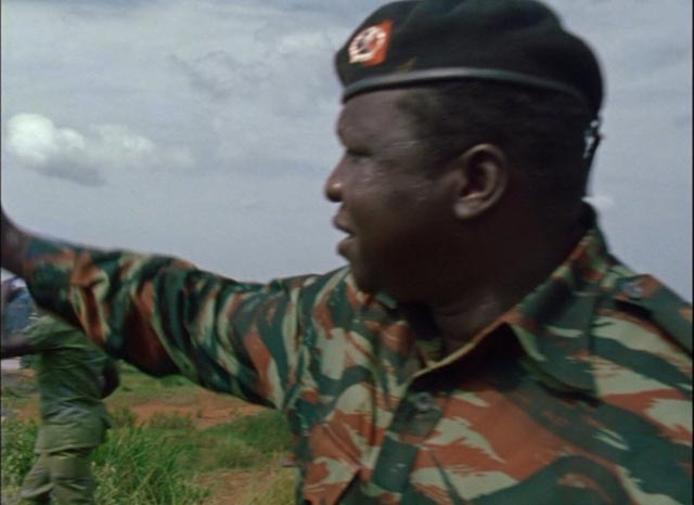 "Amin leads a mock attack on ""the Golan Heights"" in Barbet Schroeder's General Idi Amin Dada: A Self-Portrait (1974)"