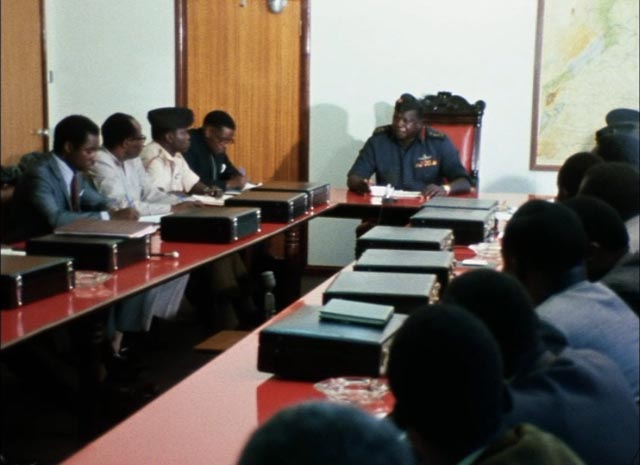 Amin lectures his cabinet on their primary duty: to make the people love him in Barbet Schroeder's General Idi Amin Dada: A Self-Portrait (1974)