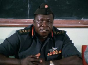 Amin listens for potential criticism at a meeting with doctors in Barbet Schroeder's General Idi Amin Dada: A Self-Portrait (1974)