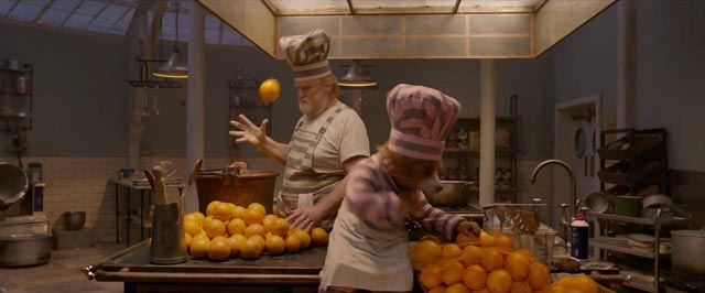 Paddington befrends the menacing prison cook, Knuckles McGinty (Brendan Gleeson) in Paul King's Paddington 2 (2017)