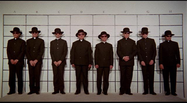 A police line-up, looking for a murderous priest in Mike Hodges' Pulp (1972)