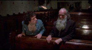 Reno (Abel Ferrara as Jimmy Laine) is horrified by an old derelict in church in Ferrara's The Driller Killer (1979)