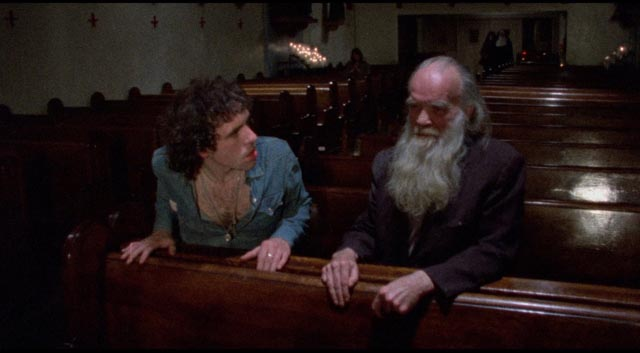 Reno (Abel Ferrara as Jimmy Laine) is horrified by an old derelict in church in Ferrara's The Driller Killer (1979)