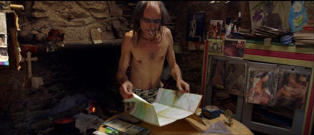 Uranie displays a map of the region in which mystical figures can be discerned in Richard Stanley's The Otherworld @013)