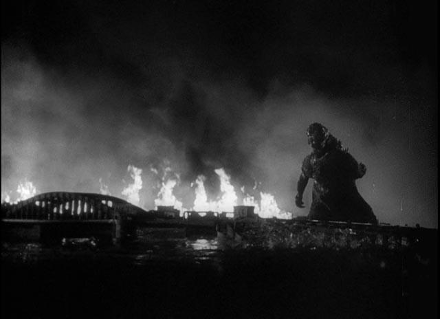 Godzilla looming over a devastated city