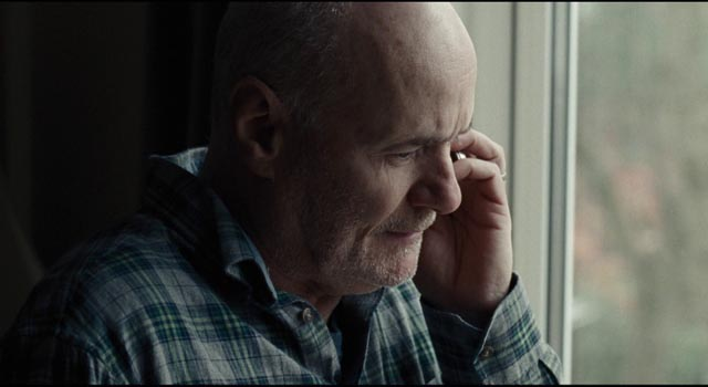 Daniel spends hours on hold as he tries to navigate the Kafkaesque bureaucracy in Ken Loach's I, Daniel Blake (2016)