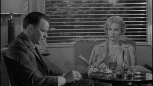 Eugenie Rose (Janet Leigh) watches Marco try to light a cigarette in the club car in John Frankenheimer's The Manchurian Candidate (1962)