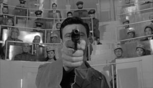 Raymond's conditioning is tested before an appreciative audience in John Frankenheimer's The Manchurian Candidate (1962)